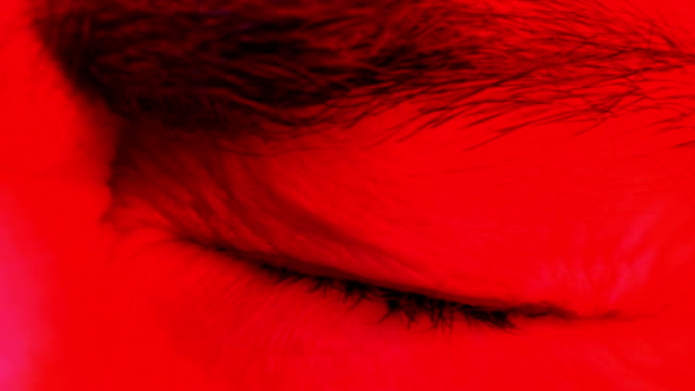 Macro-closeup-of-man-open-his-closed-eyes-and-looking-up-and-into-camera