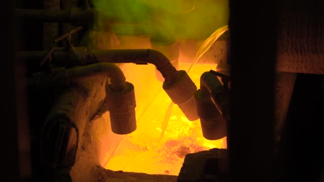 Hot-steel-pouring-at-steel-plant-In-the-frame-molten-metal-is-poured-through-special-channels-for-the-further-rolling-with-a-special-machine-Modern-metallurgical-industry