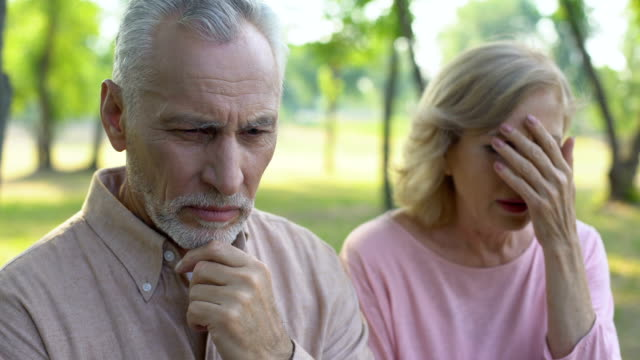 Senior-man-feels-guilty-about-cheating-wife-crying-in-despair-divorce