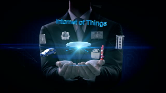 Businessman-opens-two-palms-Smart-house-Factory-Building-Car-Mobile-internet-sensor-connect-Internet-of-things-artificial-intelligence-4k-movie-