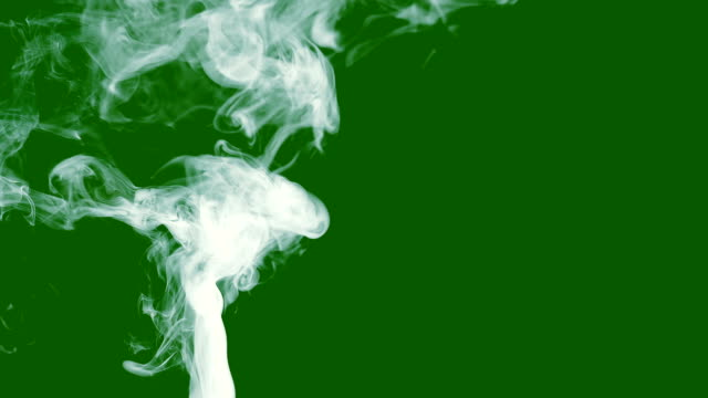slow-motion-of-smoke-or-steam-on-a-green-isolated-screen