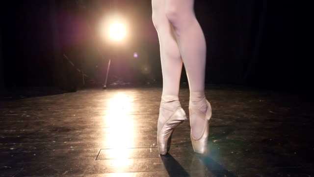 Dancing-ballerinas-feet-in-stockings-and-pointe-shoes-