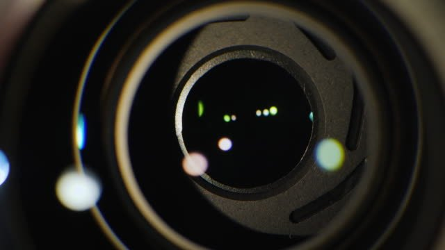 A-close-up-of-the-lens-of-a-video-camera-The-light-source-illuminates-the-lenses-then-goes-into-darkness