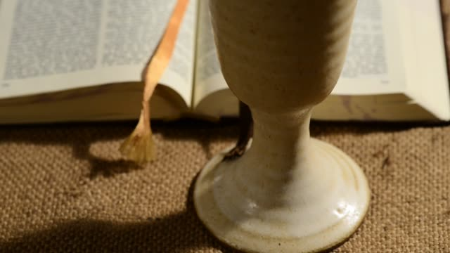 bible-with-chalice-of-wine-sliding-tilt