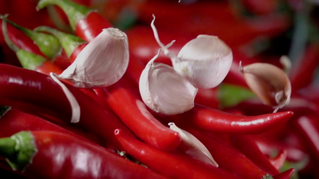 Falling-of-garlic-into-the-red-hot-pepper-Slow-motion-480-fps