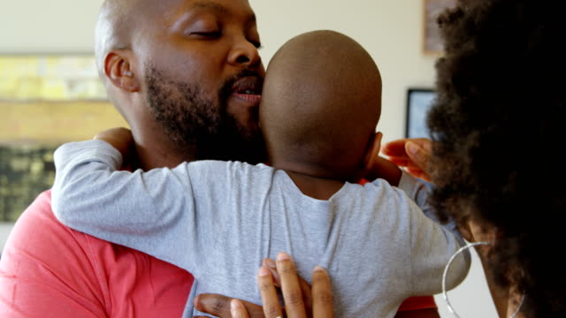 Parents-consoling-their-son-at-home-4k