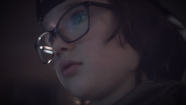 4K-Close-up-Child-with-Glasses-Playing-Video-Game