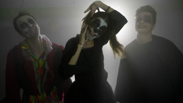Halloween-vampire-joker-and-horror-doll-scaring-the-viewer-and-laughing-crazy-in-slow-motion-party