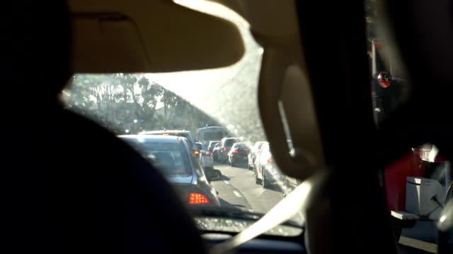 Car-stuck-in-traffic-jam-in-California-in-slow-motion
