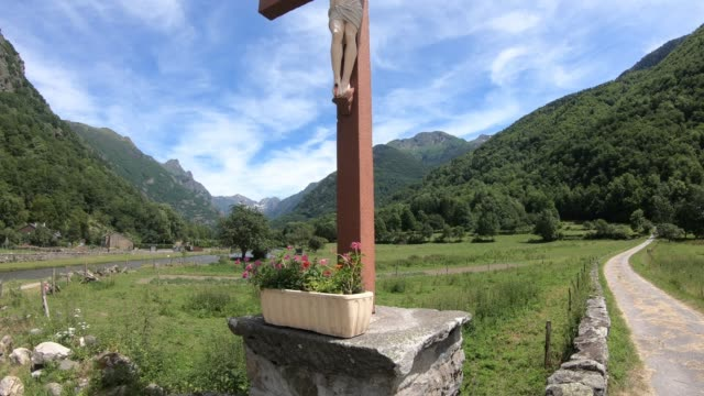 Cross-of-jesus-in-front-of-pyrenean-mountains-France
