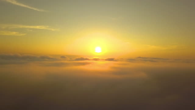 Flying-moving-over-the-clouds-tranquil-with-golden-sun-in-forenoon-