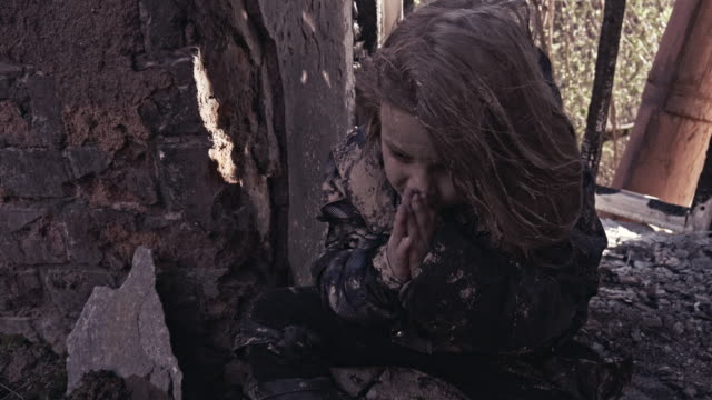 Hungry-Homeless-Child-Near-The-Ruins-Refugees