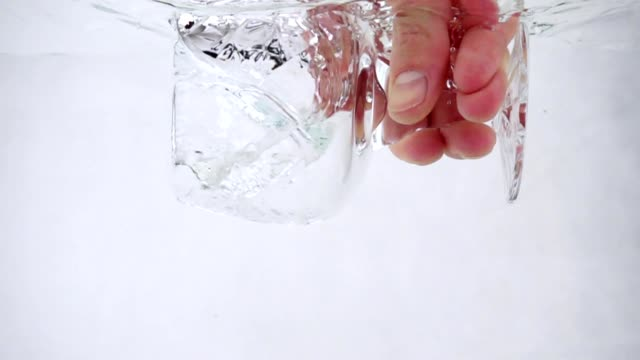 A-man-holds-a-goblet-in-his-hand-and-pours-water-into-it-close-up-slow-motion