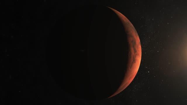 Planeta-Marte-desde-el-espacio-La-cámara-vuela-alrededor-de-Marte-Vista-desde-el-espacio-Centellean-de-estrellas-4-K-del-sol-a-la-derecha