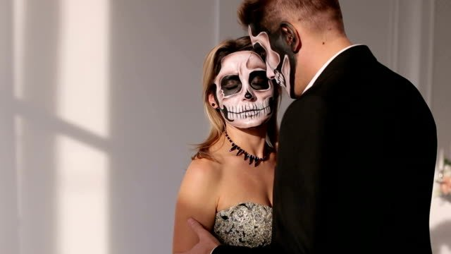 A-man-and-a-woman-in-a-dress-and-costume-with-a-creepy-Halloween-makeup-