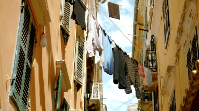 Clothes:-t-shirts-trousers-shirts-linen-hanging-on-a-rope-to-dry-outdoors-4K