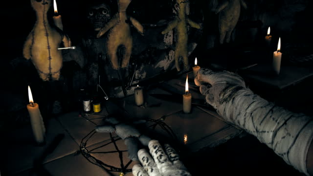 the-mage-conducts-a-ritual-with-the-voodoo-doll