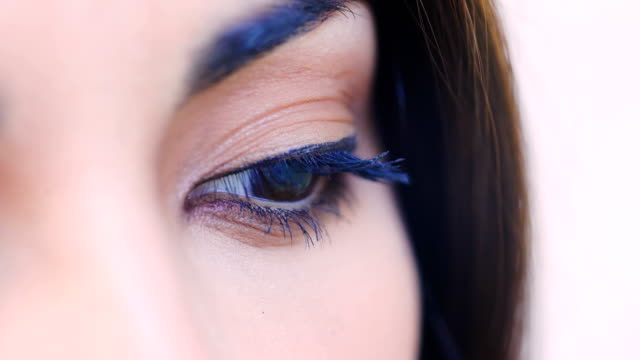 Close-up-portrait-of-pensive-sad-Asian-woman-open-her-eyes
