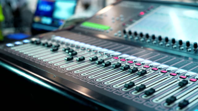 Audio-mixer-in-a-studio-the-automatic-knobs-moving-up