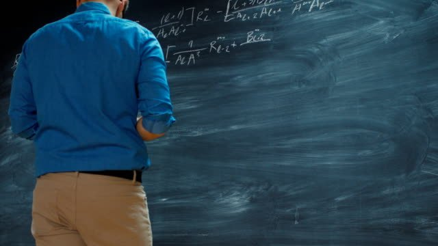 Time-Lapse-of-the-Brilliant-Young-Mathematician-Writing-Formula-on-the-Blackboard-