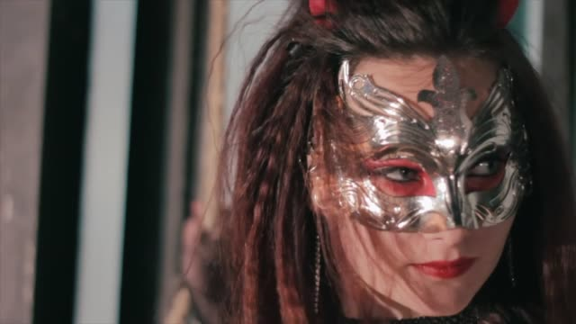 Sexy-woman-wearing-venetian-masquerade-carnival-mask-at-party-Holiday-make-up-and-accessories