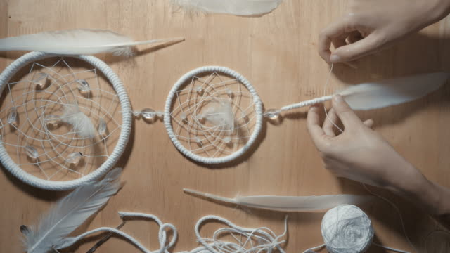 Female-Hands-Creating-Dream-Catcher-Closeup-vertical-angle