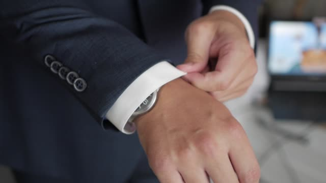 The-man-adjusts-his-sleeves-shirts