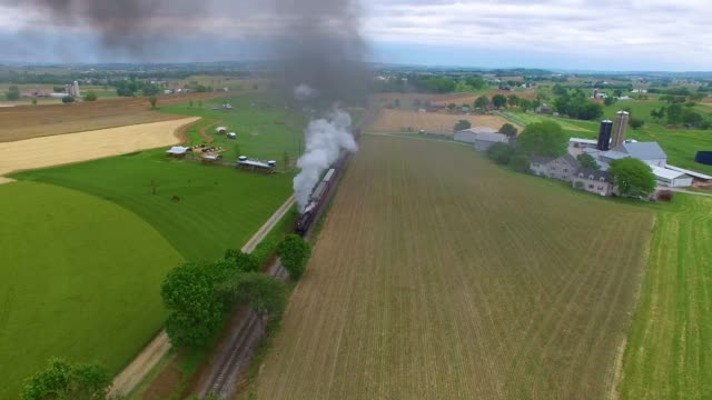 Steam-Engine-Train-Puffing-along-Countryside