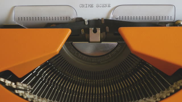 Close-up-footage-of-a-person-writing-CRIME-SCENE-on-an-old-typewriter-with-sound-