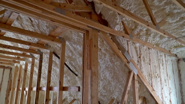 Closeup-on-termal-insulation-installing-at-the-attic-insulation-of-the-house