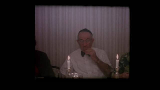 1963-Jewish-family-eats-Matzo-at-Passover-seder-table