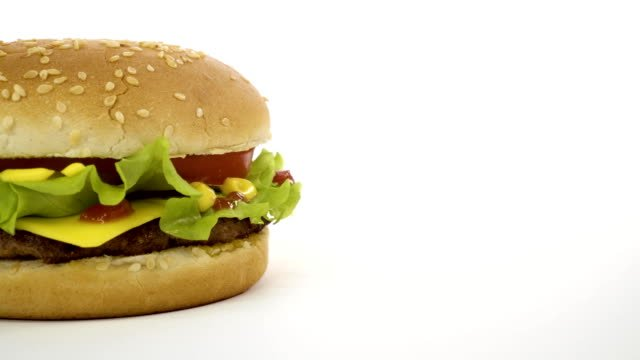 Rotation-of-an-appetizing-burger-on-a-white-background