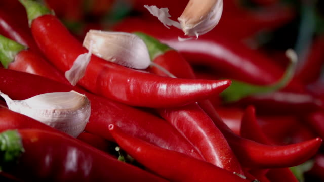 Falling-of-garlic-into-the-red-hot-pepper-Slow-motion-240-fps