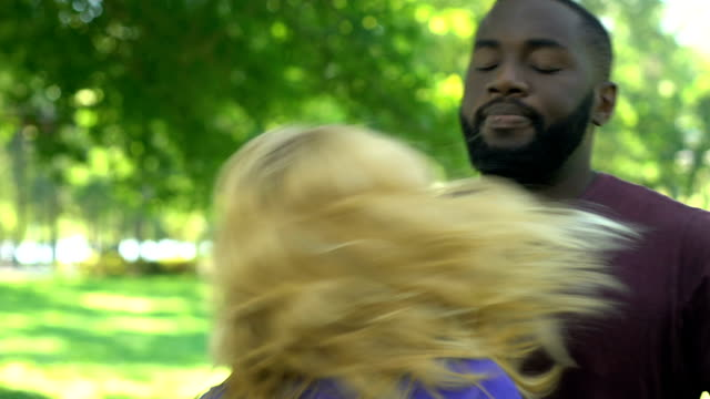 African-american-man-trying-to-calm-down-angry-disappointed-blonde-woman