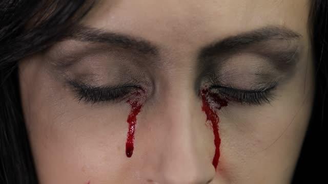 Vampire-Halloween-woman-portrait-Vampire-girl-with-dripping-blood-near-eyes