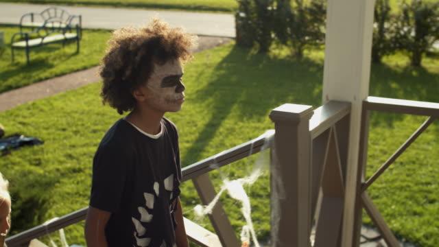 Three-Kids-Trick-of-Treating-on-Halloween