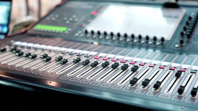 audio-mixer-in-a-studio-the-automatic-knobs-moving-up-ready-for-the-recording