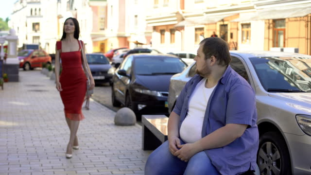 Obese-male-looking-at-beautiful-elegant-woman-lifestyle-difference-motivation