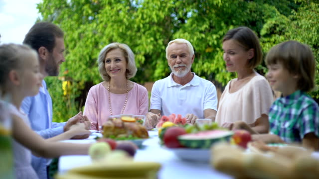 Big-family-praying-together-saying-grace-before-meal-religion-and-spirituality