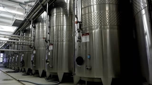 Steel-barrels-for-fermentation-of-wine-in-winemaker-factory