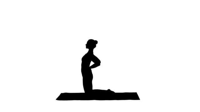 Silhouette-Sporty-beautiful-young-woman-practicing-yoga-doing-Ushtrasana-Camel-Pose
