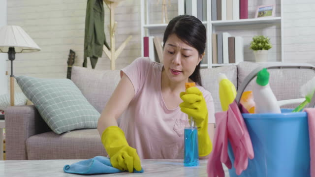 housewife-trying-hard-remove-dust-on-table