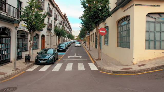 Tenerife-Canary-Islands-Spain---January-2019:-Typical-street-of-a-European-city-The-car-is-approaching-the-road-Traffic-sign-in-foreground---no-traffic-Can-be-used-to-illustrate-spain-portugal
