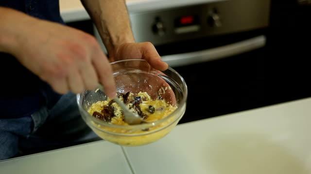 A-man-mixes-ingredients-to-prepare-a-paste-of-Carbonara
