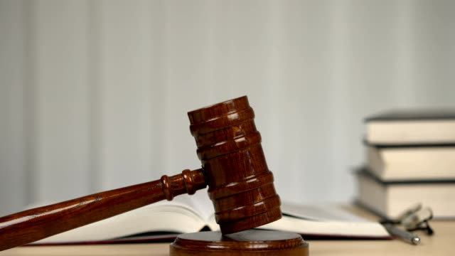 Judge-gavel-on-desk-in-empty-courtroom-rule-of-law-justice-freedom