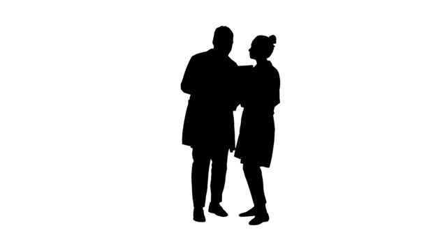 Silhouette-Serious-nice-woman-doctor-and-afro-american-doctor-study-brain-x-ray