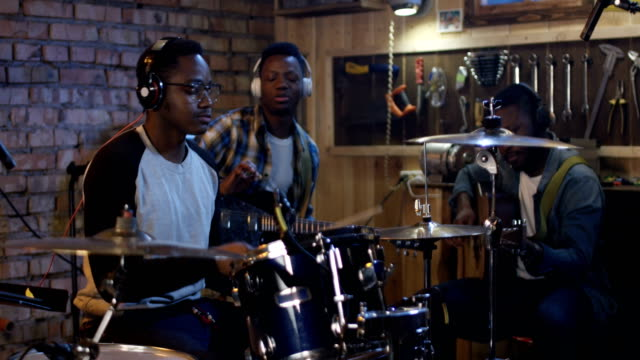 Young-musicians-rehearsing-in-garage