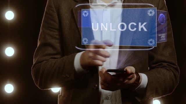 Businessman-shows-hologram-Unlock