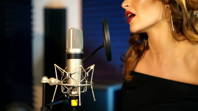 Professional-musician-records-a-new-song-in-the-recording-studio-
