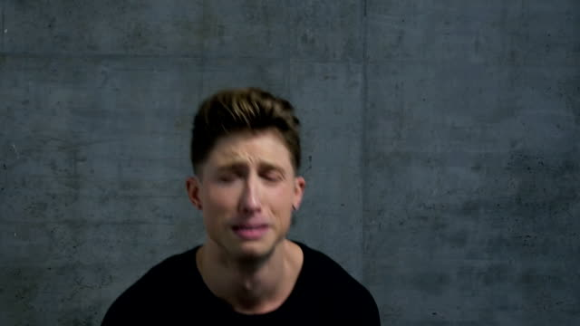 Male-Actor-Facial-Expressions-in-Studio:-Anguish-and-Tears